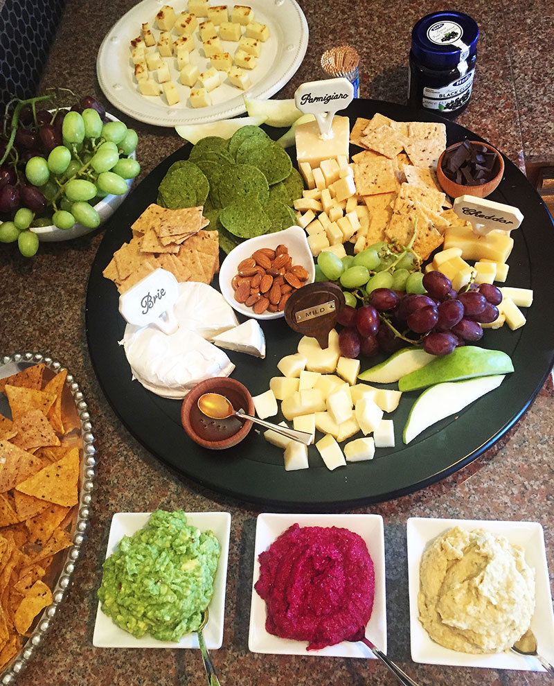 Appetizers, appetizer platter, cheese platter, cheese, brie, parmigiana, cheddar, beet hummus, avocado hummus, basil hummus, crackers, grapes, fruit, party, party platter, cheese tasting